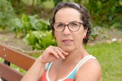Portrait of a middle-aged brunette woman with eyeglasses, outdoo Stock Photography
