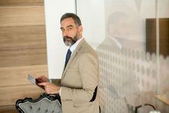 Middle aged  businessman with tablet in office Stock Photography