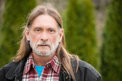 Middle aged man with long hair Stock Image