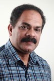 Portrait of a middle aged Indian male Stock Images