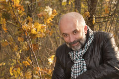 Portrait of middle-aged man. With a beard in the autumn forest Stock Photo