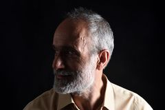 Portrait of middle aged man. On black stock photos