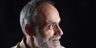 Portrait of middle aged man on black stock photography