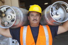Portrait of a middle-aged man carrying cylinder Stock Images