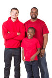 Portrait of a middle aged man and his 2 sons stock photography