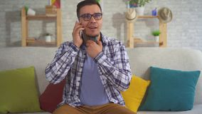 Portrait of middle-aged man answering a phone call uses Speech Aid problems with ligaments