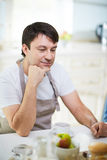 Portrait of middle-aged man in kitchen Stock Photography