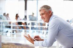 Portrait of middle aged man in office using tablet Royalty Free Stock Image