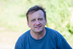 Portrait of middle-aged man relaxing in nature, close up Stock Images