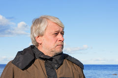 Portrait of middle-aged man at the sea. Royalty Free Stock Image