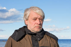 Portrait of middle-aged man at the sea. Royalty Free Stock Images