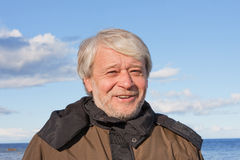 Portrait of middle-aged man at the sea. Stock Image
