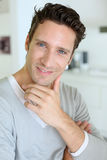 Portrait of middle-aged man standing at home stock photography