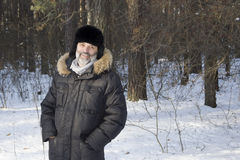 Portrait of middle-aged man in the winter forest Stock Image