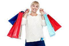 Portrait of a middle aged shopaholic woman Royalty Free Stock Photography