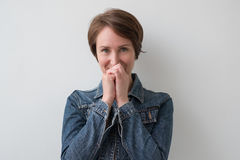 Portrait of a middle-aged shy woman. Royalty Free Stock Images