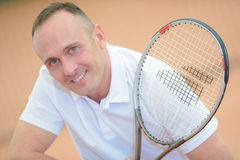 Portrait middle aged tennis player Stock Photography