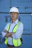 Portrait of a middle-aged warehouse worker standing with arms crossed Royalty Free Stock Image