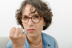 Portrait of a middle-aged woman angry Stock Photos