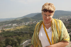 Portrait of a middle-aged woman on the background of the city an Stock Photography