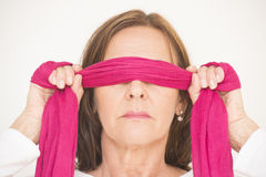 Portrait middle aged woman blindfolded Stock Photos