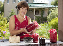 Portrait of middle aged woman with fresh berries Royalty Free Stock Photos