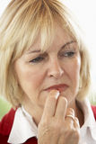 Portrait Of Middle Aged Woman Frowning stock photo