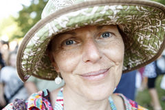 Portrait of a middle aged woman outside wearing green hat Royalty Free Stock Image