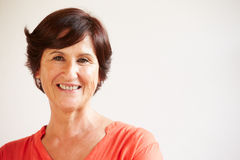Portrait Of Middle Aged Woman Standing By Wall Stock Image