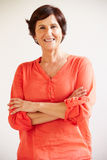 Portrait Of Middle Aged Woman Standing By Wall Royalty Free Stock Photography
