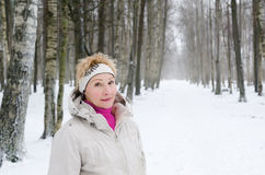 Portrait of a middle-aged woman  of a winter alley Royalty Free Stock Image