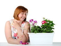 Portrait of middle-aged women, admiring plants. Stock Image
