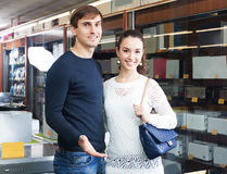 Portrait of middle class family. Couple at household appliances store stock photo