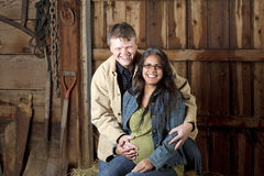 Portrait of a middle ged man and his pregnant wife in their barn Royalty Free Stock Photos