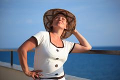 Portrait of middleaged woman in hat on balcony Royalty Free Stock Images