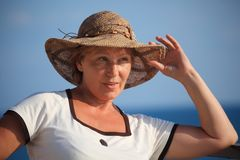 Portrait of middleaged woman in hat outdoor Royalty Free Stock Image