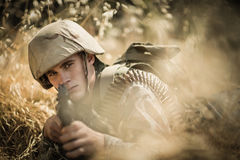 Portrait of military soldier aiming with a rifle. In boot camp stock photos