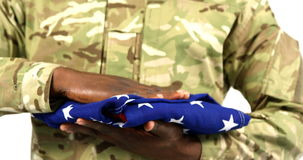 Portrait of military soldier holding US flag. On white background 4k stock footage