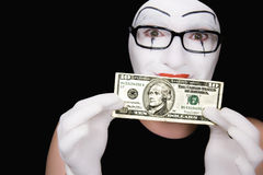 Portrait of  mime with 10 dollar denomination Royalty Free Stock Images