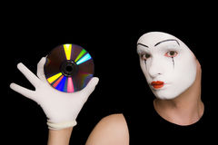 Portrait of  mime with cd on  black background Royalty Free Stock Image