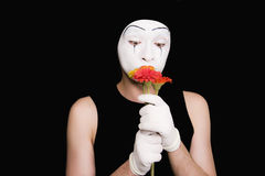 Portrait of  mime in gloves With flowers Stock Photo