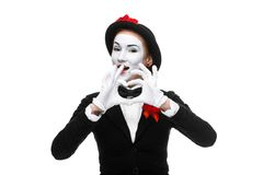 Portrait of the mime  with hands folded in  shape Stock Image