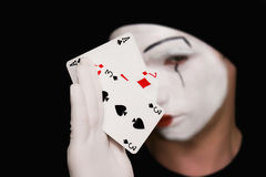 Portrait of  mime with playing cards Royalty Free Stock Photo