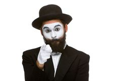 Portrait of mime with pointing finger. Portrait of the mime with pointing finger isolated on white background. concept of choice Royalty Free Stock Image