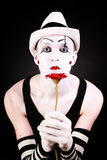 Portrait of mime with red gerbera flower Stock Photography
