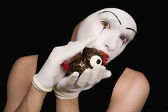 Portrait of the mime with toy birds Stock Photo