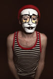 Portrait of mime wearing red hat and yellow eyeglasses Stock Photography