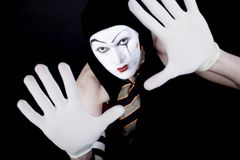 Portrait of mime in white gloves Stock Photos