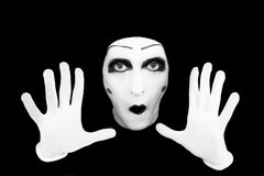 Portrait of the mime in white gloves. On a black background Stock Photography