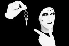 Portrait of the mime in white gloves with a key Royalty Free Stock Photography